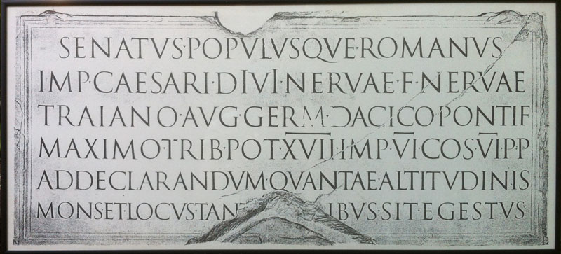 Facsimile of a rubbing taken from the inscription found at the base of Trajan's column, located on the Via dei Fori Imperiali in Rome. This Roman triumphal column was erected in AD 113 to commemorate Emperor Trajan's victory in the Dacian Wars.