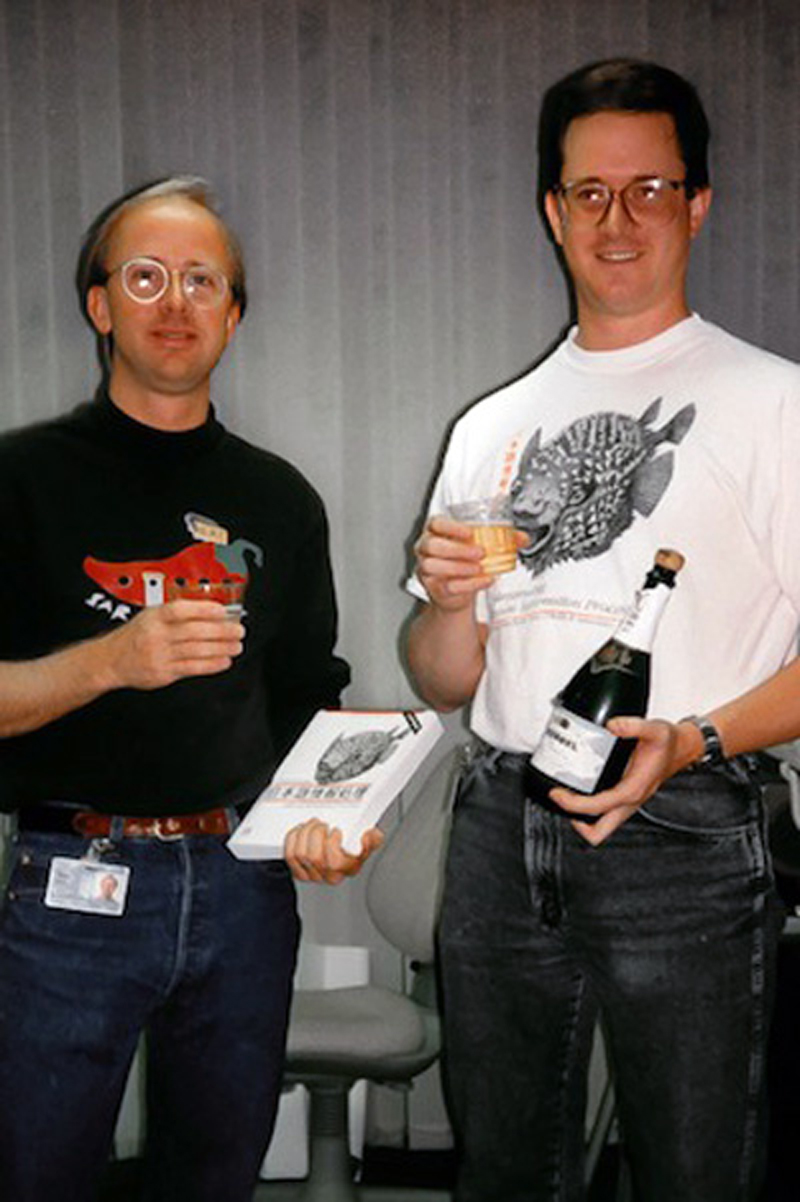 """Adobe Type's Dan Mills and Dr. Ken Lunde celebrate the publication of Lunde's book, """"Understanding Japanese Information Processing,"""" September 1993."""