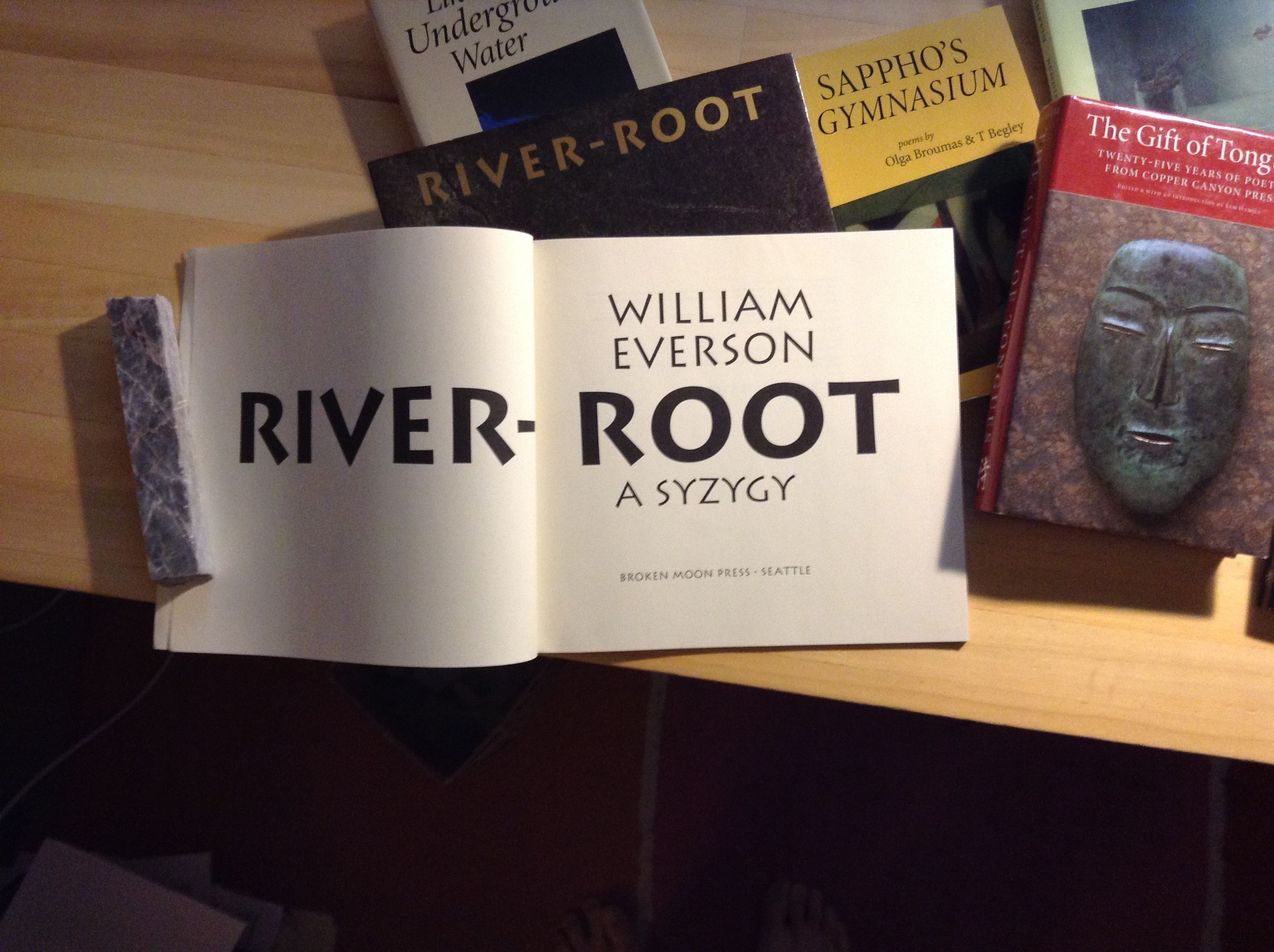 """Carol Twombly's Lithos is featured in this Broken Moon Press edition of William Everson's """"River-Root,"""" designed by John D. Berry."""