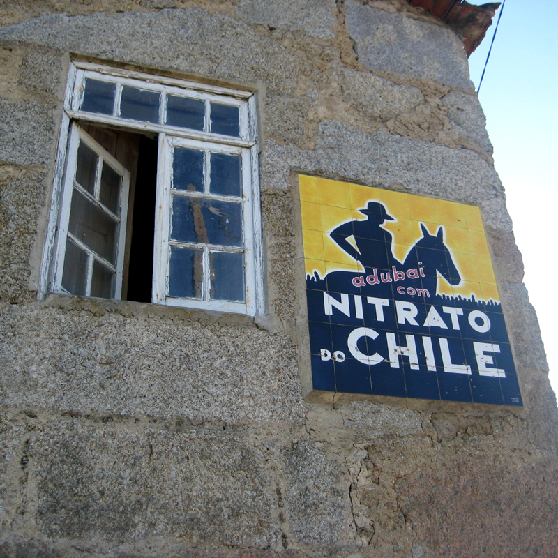 Bold angular lettering evokes Art Deco style in this advertising sign for Nitrato do Chile, found in Carrapichana, Portugal. The brand belonged to a company that sold guano fertilizer from Chile throughout Iberia during the 1920s and '30s. Signs like this can be spotted across Portugal, especially in rural areas. Photo by Márcio Martins.